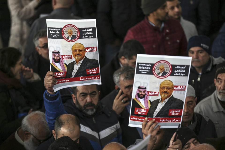 FILE - In this Nov. 16, 2018 file photo, members of Arab-Turkish Media Association and friends of Washington Post columnist Jamal Khashoggi hold posters showing images of Saudi Crown Prince Muhammed bin Salman and of Khashoggi, as they attend funeral prayers in absentia for him following his killing the previous month in the Saudi Arabia consulate, in Istanbul. A New York-based organization dedicated to the safety of journalists says the number killed worldwide in reprisal for their work, including Khashoggi, nearly doubled this year. Khashoggi was one of 53 journalists killed between Jan. 1 and Dec. 14, 2018, the committee said. (AP Photo/Emrah Gurel, File)