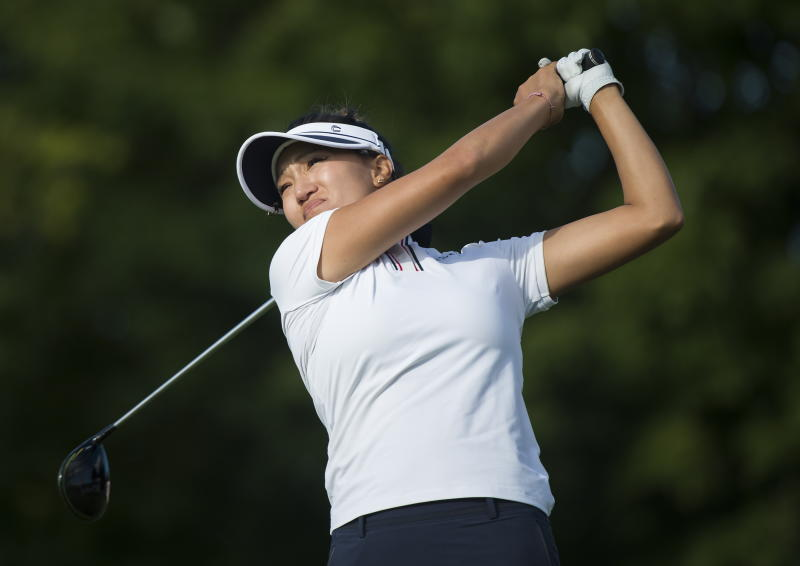 Annie Park, of the United States, watches her tee shot on the 16th hole during the first round of the CP Women's Open golf tournament in Aurora, Ontario, Thursday, Aug. 22, 2019. (Nathan Denette/The Canadian Press via AP)