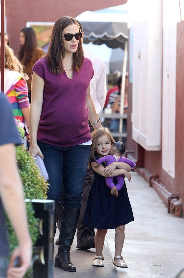 Actress Jennifer Garner (and her baby bump!) steered youngest daughter, Seraphina, around the Brentwood Country Mart in L.A. on Saturday. Dad Ben Affleck and big sis Violet were somewhere nearby as the family dined out for lunch. (11/26/2011)