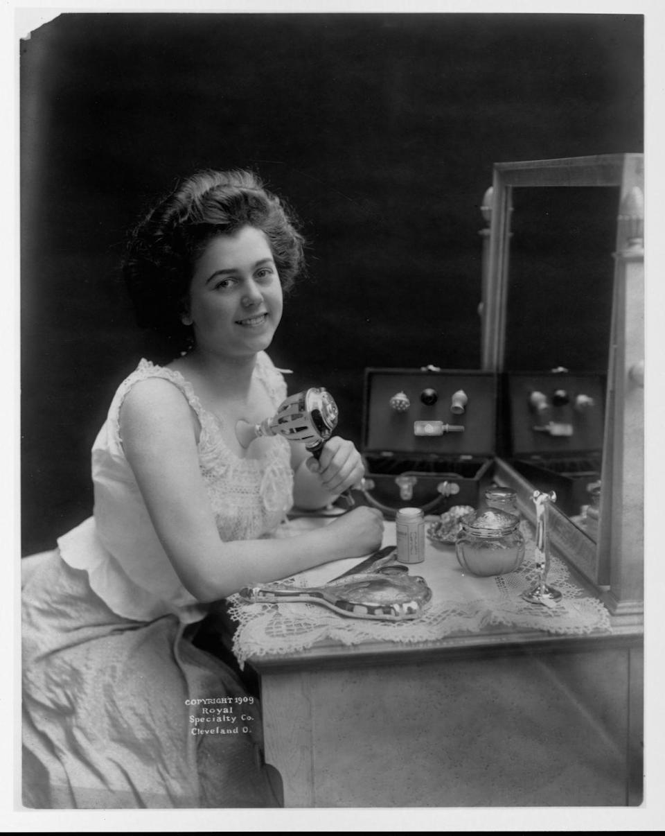 "<p>A young woman demonstrates the use of a vibrating ""chest developer"" while sitting at her vanity. According to an ad in a 1921 edition of <em>Hearst's International Magazine</em>, <a href=""https://www.collectorsweekly.com/articles/bizarro-beauty-products-from-1889-to-now/"" rel=""nofollow noopener"" target=""_blank"" data-ylk=""slk:the subtle vibrations"" class=""link rapid-noclick-resp"">the subtle vibrations</a> could help firm the muscles and prevent sagging.</p>"