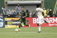 Portland Timbers forward Felipe Mora, left, pushes the ball ahead during an MLS soccer match against Los Angeles FC, Sunday, Sept. 19, 2021, in Portland, Ore. (Sean Meagher/The Oregonian via AP)
