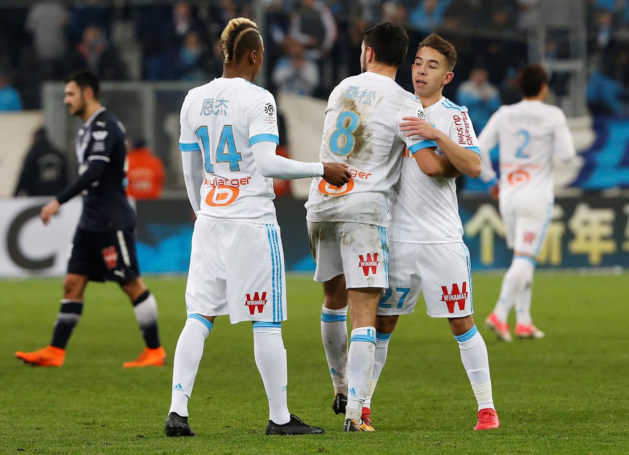 Soccer Football - Ligue 1 - Olympique de Marseille vs Bordeaux - Orange Velodrome, Marseille, France - February 18, 2018   Marseille's Maxime Lopez, Morgan Sanson and Clinton Njie celebrate after the match    REUTERS/Jean-Paul Pelissier