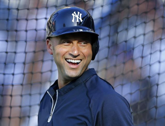 New York Yankees shortstop Derek Jeter shares a laugh during batting practice before their Major League Baseball game against the San Diego Padres in San Diego, California in this file photo taken August 2, 2013. Jeter on Wednesday said he will stop playing Major League Baseball at the end of the 2014 season. REUTERS/Mike Blake/Files (UNITED STATES - Tags: SPORT BASEBALL)