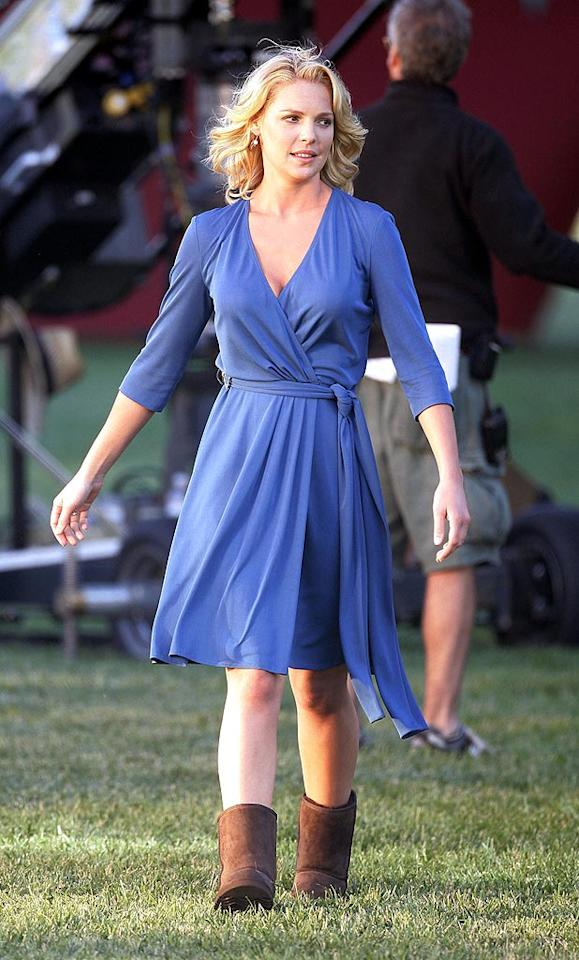 "Although she is on a movie set, Katherine Heigl should know better than to pair Uggs with such a cute wrap dress. <a href=""http://www.infdaily.com"" target=""new"">INFDaily.com</a> - June 30, 2008"
