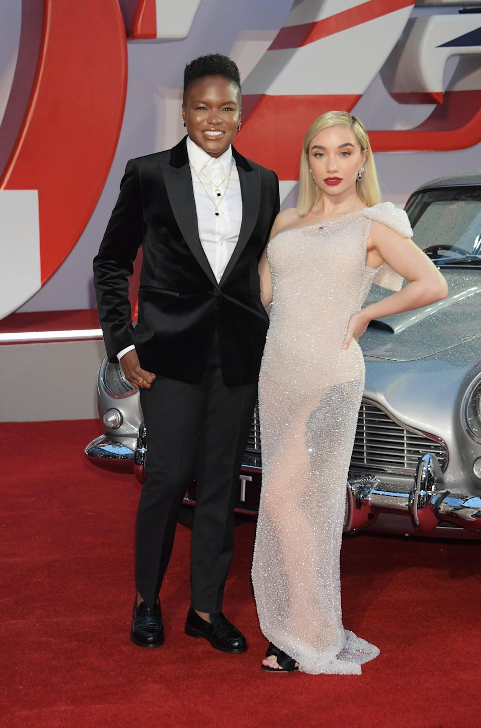 <p>Adams wore a black suit with a velvet jacket, and Baig wore a shimmery, off-the-shoulder gown. </p>