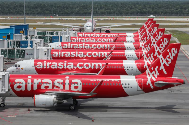 FILE PHOTO: AirAsia planes are seen parked at Kuala Lumpur International Airport 2, during the movement control order due to the outbreak of the coronavirus disease (COVID-19), in Sepang