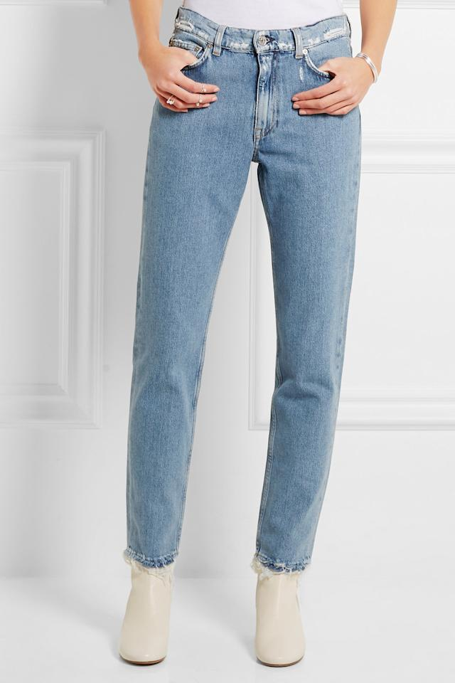 """<p>When it comes to jeans this season, it's all about the cropped look. If they are finished with frayed trims you are bound to pull off an effortless cool look.<br /><a href=""""https://www.net-a-porter.com/gb/en/product/648347?cm_mmc=LinkshareUK-_-0RpXOIXA500-_-Custom-_-LinkBuilder&siteID=0RpXOIXA500-534pxN4UQ7oBGCnON5pF.g""""><i>[Acne Studio's, £220]</i></a></p>"""