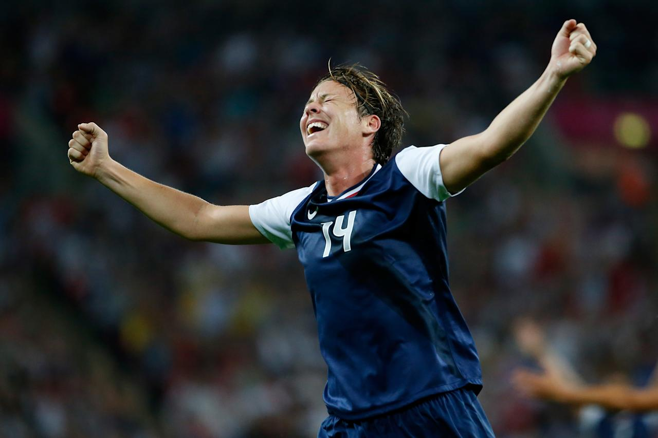 LONDON, ENGLAND - AUGUST 09:  Abby Wambach #14 of United States reacts after a goal by Carli Lloyd #10 in the second halfagainst Japan during the Women's Football gold medal match on Day 13 of the London 2012 Olympic Games at Wembley Stadium on August 9, 2012 in London, England.  (Photo by Jamie Squire/Getty Images)