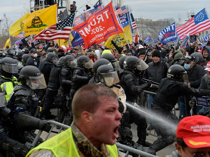 Trump supporters clash with police and security forces as people try to storm the US Capitol in Washington DC on 6 January 2021 (AFP via Getty Images)