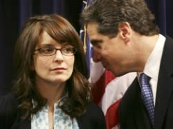 Tina Fey chats world domination with New York governor-elect Andrew Cuomo. Mark Lennihan/Associated Press