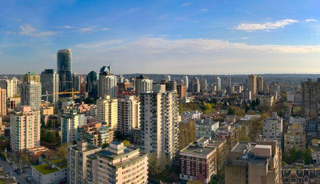 An aerial view of apartment and condo buildings in Vancouver's West End, with Robson Street on the right.