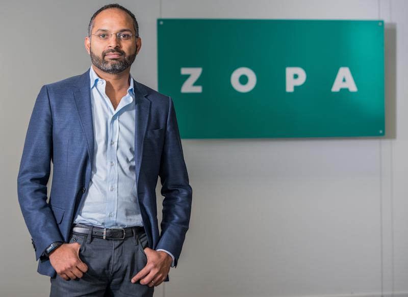 Jaidev Janardana of Zopa next to a logo