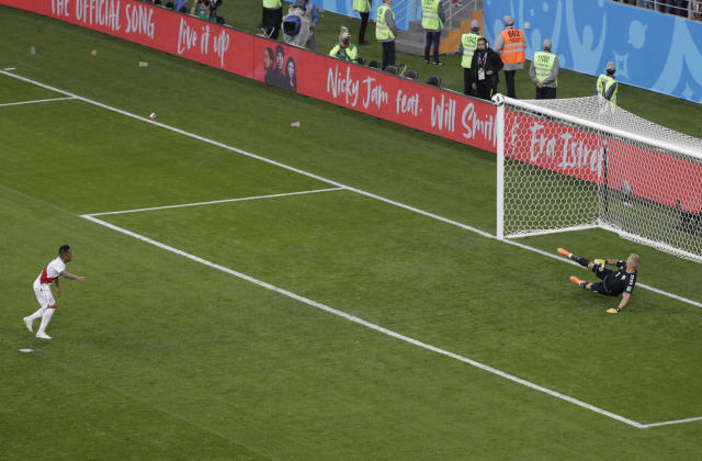 <p>High and wide: Christian Cueva blasts his penalty way over the bar to blow Peru's golden chance to take the lead. (AP) </p>