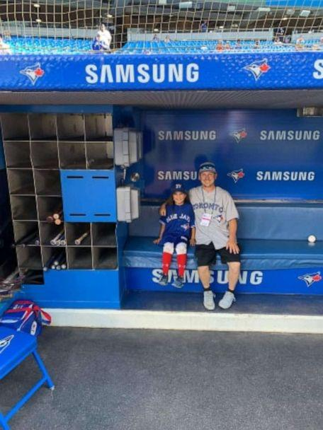 PHOTO: Ashlynn and Dan Theiren in the dugout at a Toronto Blue Jays game. (Kerri Jolicoeur)