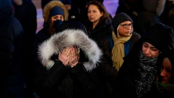 PHOTO: A woman mourns outside the Alberta Legislature Building in Edmonton, Alberta, Wednesday, Jan. 8, 2020, during a vigil for those killed after a Ukrainian passenger jet crashed, killing at least 63 Canadians. (Codie Mclachlan/AP)