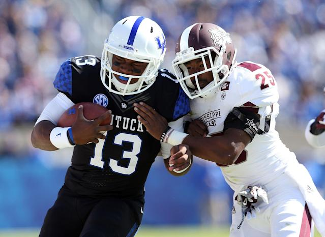 LEXINGTON, KY - OCTOBER 06: Jalen Whitlow #13 of the Kentucky Wildcats runs with the ball while defended by Corey Broomfield #25 of the Mississippi State Bulldogs during the SEC game at Commonwealth Stadium on October 6, 2012 in Lexington, Kentucky. (Photo by Andy Lyons/Getty Images)