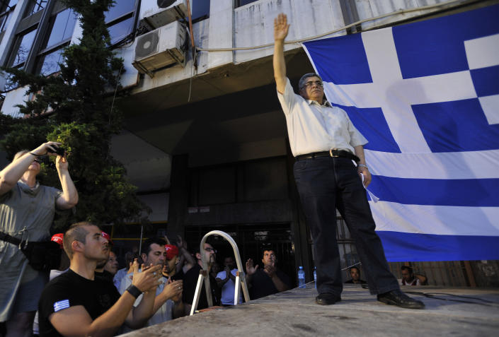 FILE - In this Sunday, June. 10, 2012 file photo, Nikolaos Michaloliakos, leader of the extreme right-wing Golden Dawn party, waves to supporters during a pre-election rally at the northern port city of Thessaloniki Greece. Greek police said Mihaloliakos was arrested on Saturday Sept. 28, 2013, on charges of forming a criminal organization. Warrants for the arrest of the party's another five parliament deputies have been issued. The police counterterrorism unit is looking for the deputies. More warrants are expected. The arrests come several days after the killing of a left-wing activist rapper by an alleged party member. (AP Photo/Nicolas Giakoumidis, File)