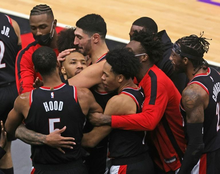 Portland's Damian Lillard (facing camera) is mobbed by Trail Blazers teammates after sinking the game-winning basket in a 123-122 NBA victory over the Chicago Bulls