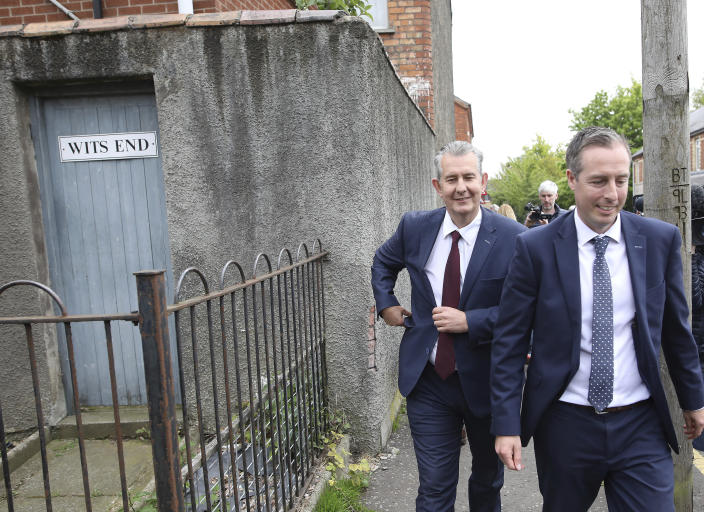 Democratic Unionist Party members Edwin Poots and Paul Girvan, right, leave the party headquarters in east Belfast after voting took place to elect a new leader on Friday May 14, 2021. Edwin Poots and Jeffrey Donaldson are running to replace Arlene Foster. (AP Photo/Peter Morrison)