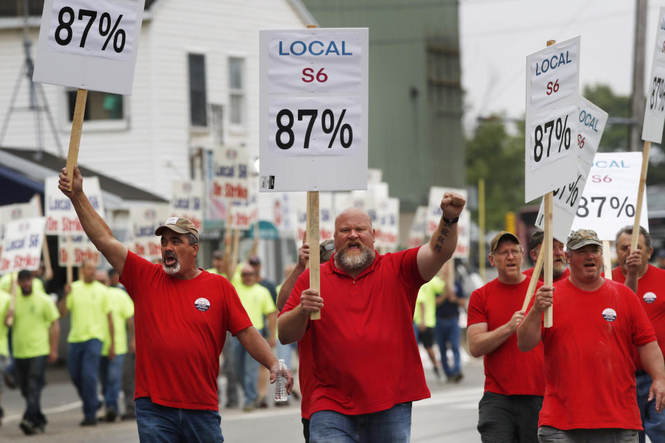 Union members picket outside Bath Iron Works, Monday, June 22, 2020, in Bath, Maine. Production workers at one of the Navy's largest shipbuilders overwhelmingly voted to strike, rejecting the company's three-year contract offer Sunday and threatening to further delay delivery of ships. (AP Photo/Robert F. Bukaty)