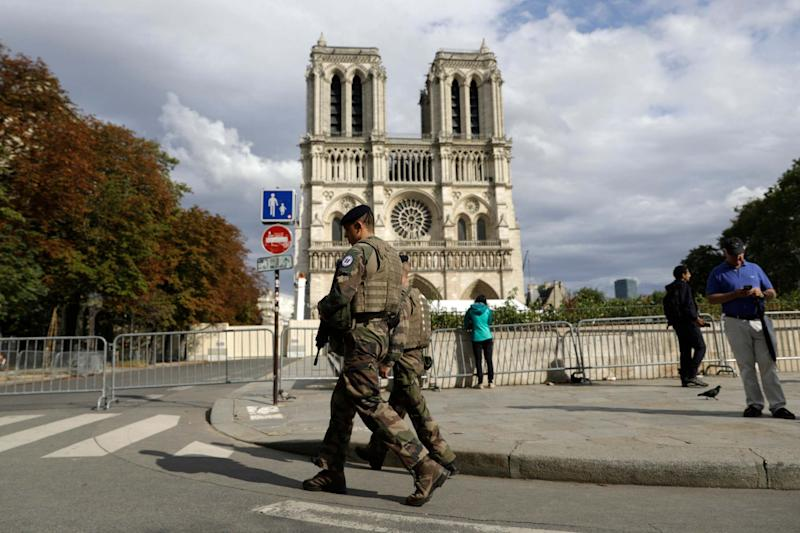 French soldiers clear the area around Notre Dame (AP)