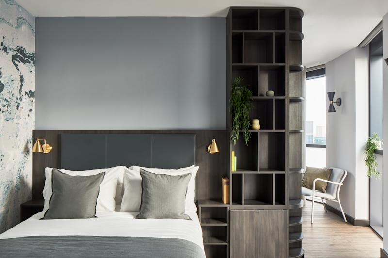 A bedroom at The Collective Canary Wharf costs about $130 a night.