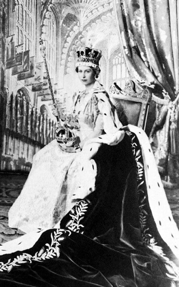 <p>Wearing the Crown Jewels on her Coronation Day at Westminster Abbey.<br /><i>[Photo: Getty]</i> </p>