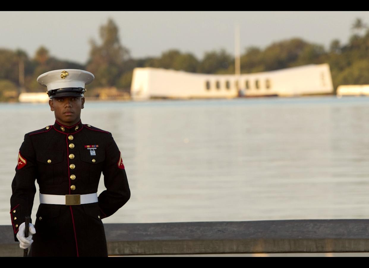 Another Marine stands at attention in the early morning of Dec. 7.
