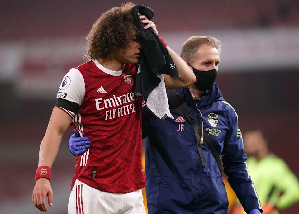 <p>David Luiz plays on after the clash of heads</p>POOL/AFP via Getty Images