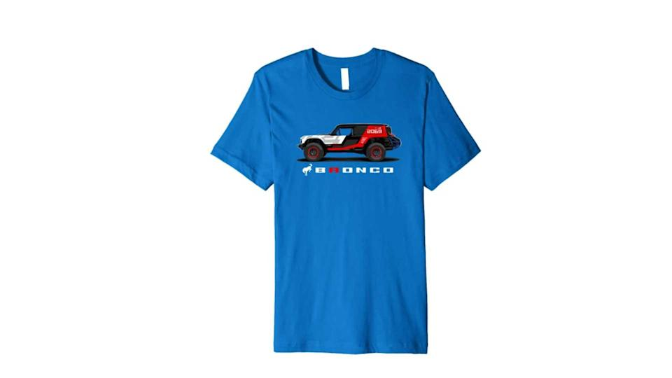"<p>We include this t-shirt because it's the only item in the entire store that features the new Bronco. Rather, it features a racing version of the new Bronco, specifically the R model that ran at Baja.</p>   <ul><li><a href=""https://www.motor1.com/news/431995/watch-2021-ford-bronco-debut-july-13/?utm_campaign=yahoo-feed"" rel=""nofollow noopener"" target=""_blank"" data-ylk=""slk:How To Watch The 2021 Ford Bronco Debut On July 13"" class=""link rapid-noclick-resp"">How To Watch The 2021 Ford Bronco Debut On July 13</a></li><br><li><a href=""https://www.motor1.com/news/432769/2021-ford-bronco-spy-shots-interior/?utm_campaign=yahoo-feed"" rel=""nofollow noopener"" target=""_blank"" data-ylk=""slk:2021 Ford Bronco Spy Shots Reveal Off-Roader's Interior"" class=""link rapid-noclick-resp"">2021 Ford Bronco Spy Shots Reveal Off-Roader's Interior</a></li><br></ul>"