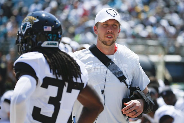 Jacksonville Jaguars quarterback Nick Foles, right, walks through the bench area with his arm in a sling after he was injured during the first half of an NFL football game against the Kansas City Chiefs, Sunday, Sept. 8, 2019, in Jacksonville, Fla. (AP Photo/Stephen B. Morton)