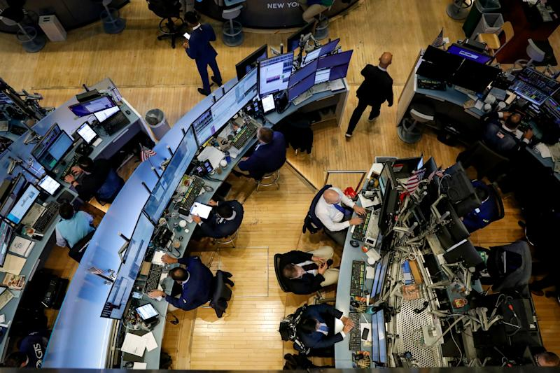 Traders work on the floor at the New York Stock Exchange (NYSE) in New York, U.S., September 9, 2019. REUTERS/Brendan McDermid
