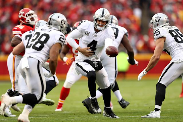 Quarterback Derek Carr #4 of the Oakland Raiders in action during a game against the Kansas City Chiefs. (Getty)