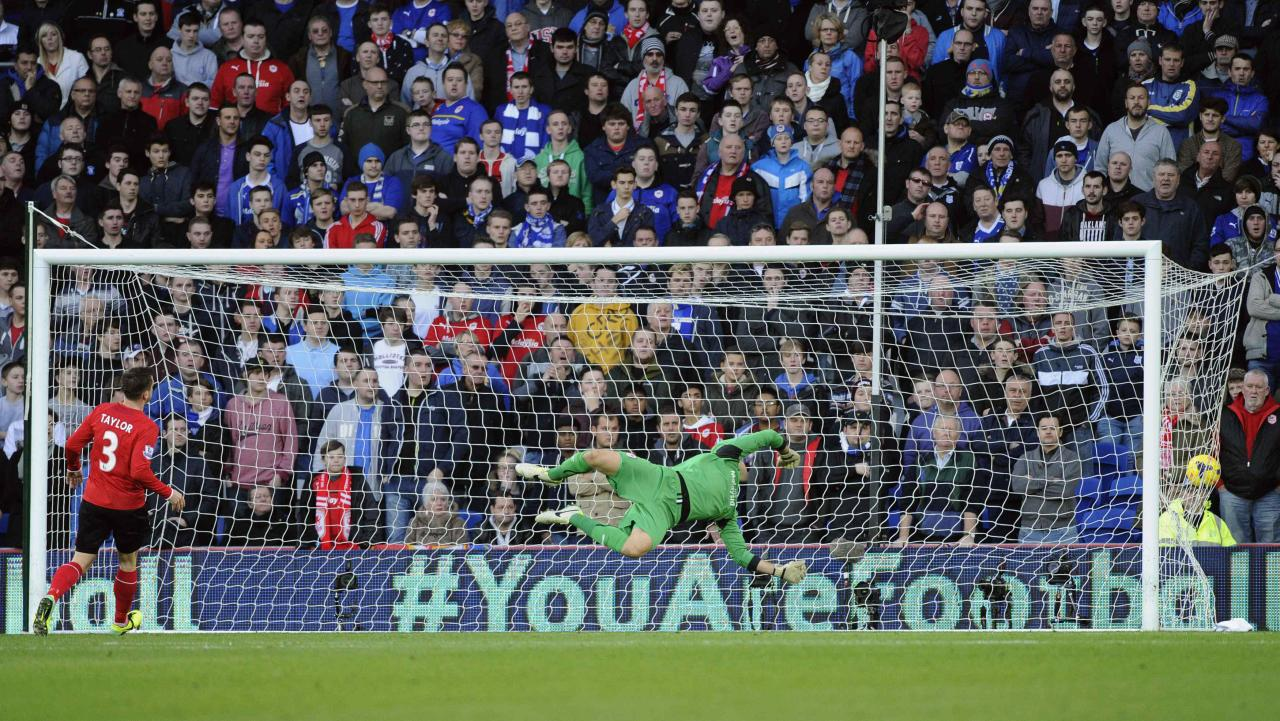 "Cardiff City's goalkeeper David Marshall fails to stop a goal being scored by Arsenal's Aaron Ramsey (not pictured) during their English Premier League soccer match at Cardiff City Stadium in Cardiff, Wales, November 30, 2013. REUTERS/Rebecca Naden (BRITAIN - Tags: SPORT SOCCER) NO USE WITH UNAUTHORIZED AUDIO, VIDEO, DATA, FIXTURE LISTS, CLUB/LEAGUE LOGOS OR ""LIVE"" SERVICES. ONLINE IN-MATCH USE LIMITED TO 45 IMAGES, NO VIDEO EMULATION. NO USE IN BETTING, GAMES OR SINGLE CLUB/LEAGUE/PLAYER PUBLICATIONS. FOR EDITORIAL USE ONLY. NOT FOR SALE FOR MARKETING OR ADVERTISING CAMPAIGNS"