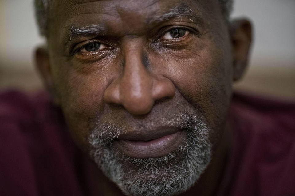 Mike Bishop poses for a portrait in his home in Byram, Miss., on Thursday, Oct. 8, 2020. In early July, Bishop was hit by COVID-19. He was exhausted and achy, but never had to be hospitalized. But for Bonnie Bishop, his wife, coronavirus hit like a tsunami. (AP Photo/Wong Maye-E)