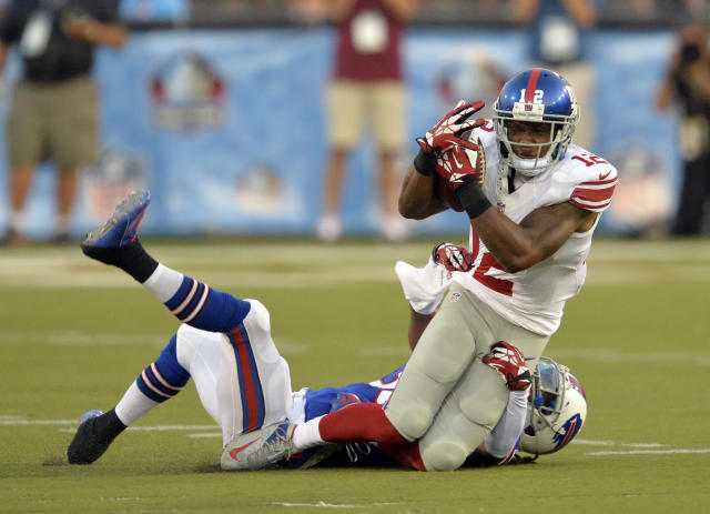New York Giants wide receiver Jerrel Jernigan, top, catches a pass for a first down under pressure from Buffalo Bills defensive back Mario Butler during the first quarter at the Pro Football Hall of Fame exhibition NFL football game Sunday, Aug. 3, 2014, in Canton, Ohio. (AP Photo/David Richard)