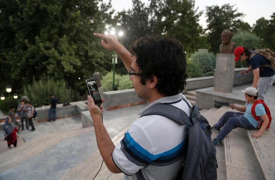 Iran has banned global gaming craze Pokemon Go but tech-savvy youths have carried on regardless (AFP Photo/Atta Kenare)