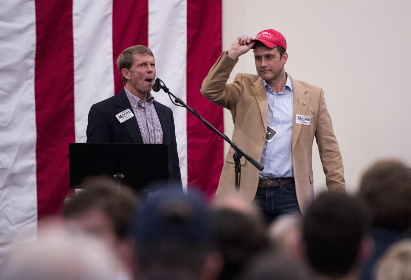 "Paul Nehlen, right, is introduced at a ""Drain the Swamp"" Roy Moore campaign event in Midland City, Alabama, on Monday. (Bill Clark via Getty Images)"
