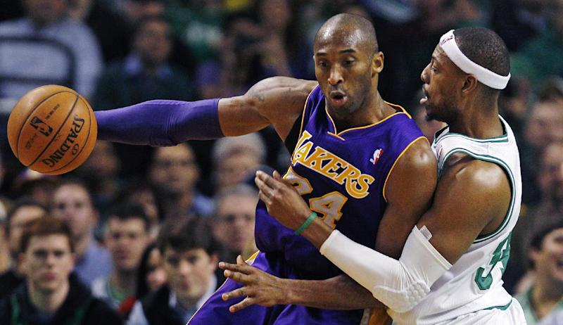 Boston Celtics forward Paul Pierce, right, pressures Los Angeles Lakers guard Kobe Bryant, left, on a drive to the basket during the second quarter of an NBA basketball game in Boston, Thursday, Feb. 7, 2013. (AP Photo/Charles Krupa)