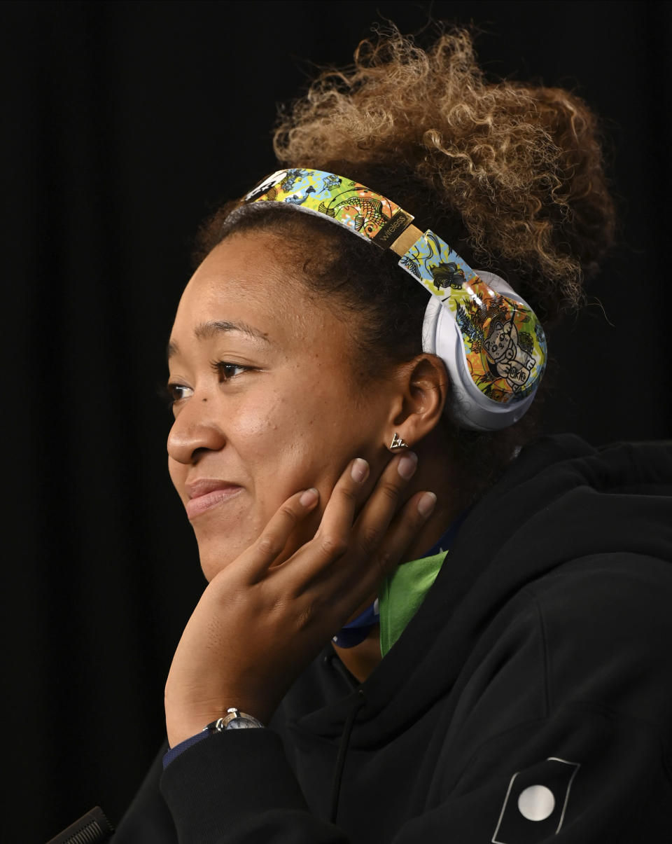 Japan's Naomi Osaka reacts during a press conference following her quarterfinal win over Taiwan's Hsieh Su-wei at the Australian Open tennis championship in Melbourne, Australia, Tuesday, Feb. 16, 2021.(Vince Caligiuri/Tennis Australia via AP)
