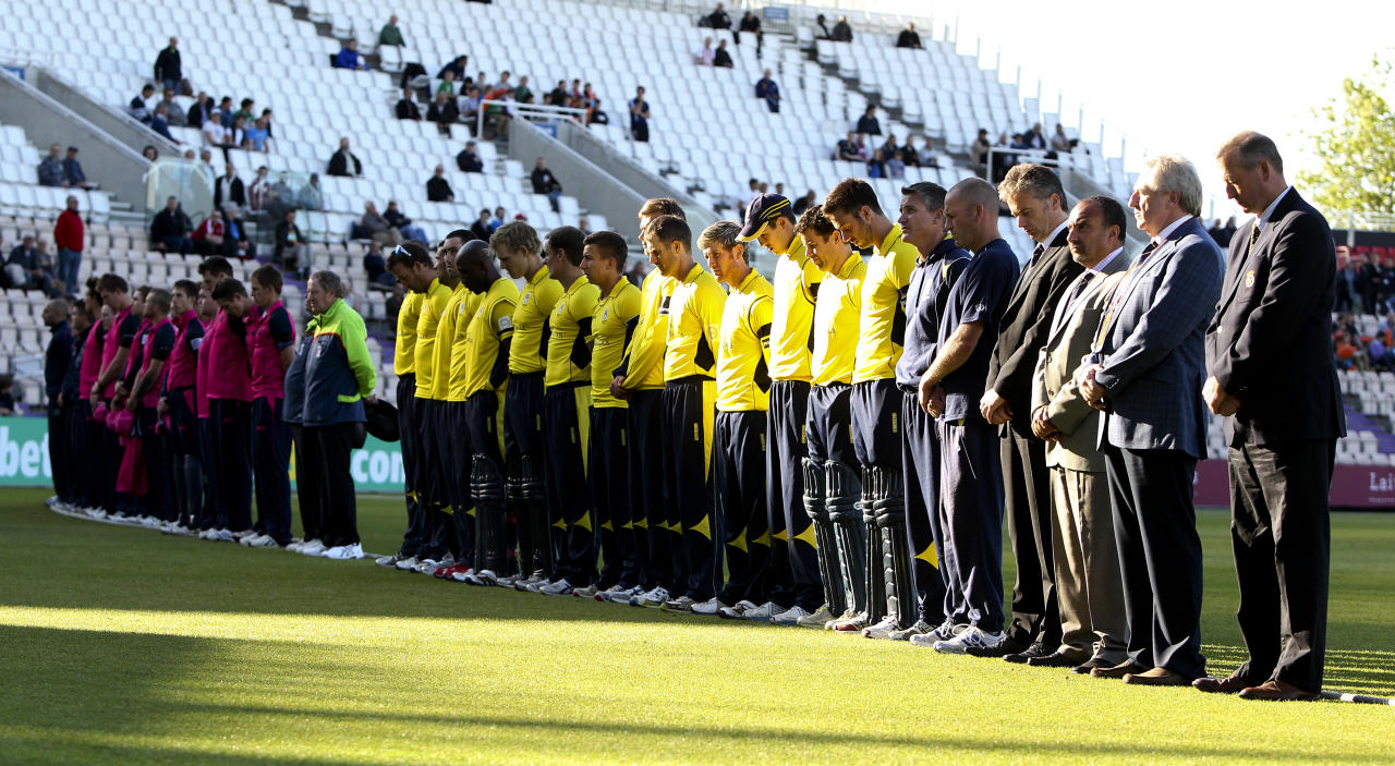 SOUTHAMPTON, ENGLAND - JUNE 18:  Players and couty officials from both teams observe a minutes silence in memory of Tom Maynard during the Friends Life T20 match between Hampshire and Middlesex at the Ageas Bowl on June 18, 2012 in Southampton, England. (Photo by Ben Hoskins/Getty Images)
