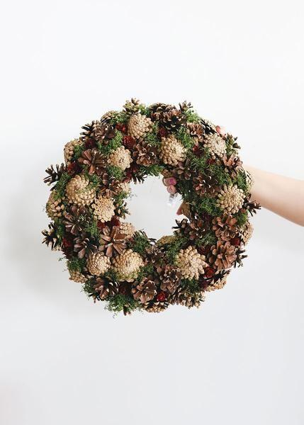 "<p>afloral.com</p><p><strong>$35.00</strong></p><p><a href=""https://www.afloral.com/products/artificial-christmas-pine-wreath-with-cones-red-brown-14w"" rel=""nofollow noopener"" target=""_blank"" data-ylk=""slk:Shop It"" class=""link rapid-noclick-resp"">Shop It</a></p><p>A nature wreath full of pine cones feel like subtle a celebration of fall.</p>"