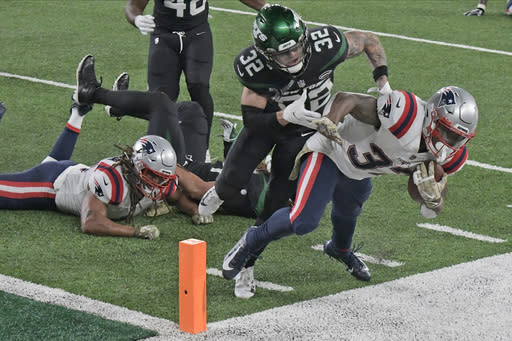 New England Patriots' Damien Harris, right, is pushed out of bounds by New York Jets' Ashtyn Davis (32) just before the end zone during the second half of an NFL football game, Monday, Nov. 9, 2020, in East Rutherford, N.J. (AP Photo/Bill Kostroun)