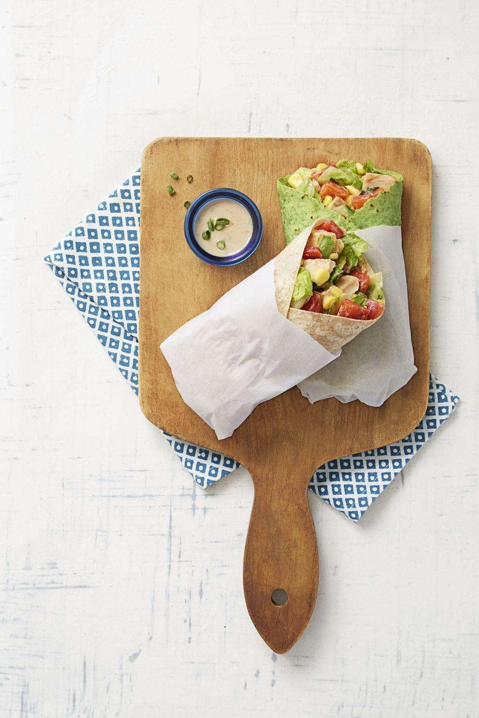 """<p>It doesn't <em>feel </em>like eating a sad salad when all the healthy fixings are tucked inside a colorful wrap.</p><p><em><a href=""""https://www.goodhousekeeping.com/food-recipes/a32409/bbq-ranch-chicken-wraps-recipe-ghk0515/"""" rel=""""nofollow noopener"""" target=""""_blank"""" data-ylk=""""slk:Get the recipe for BBQ-Ranch Chicken Wraps »"""" class=""""link rapid-noclick-resp"""">Get the recipe for BBQ-Ranch Chicken Wraps »</a></em></p>"""