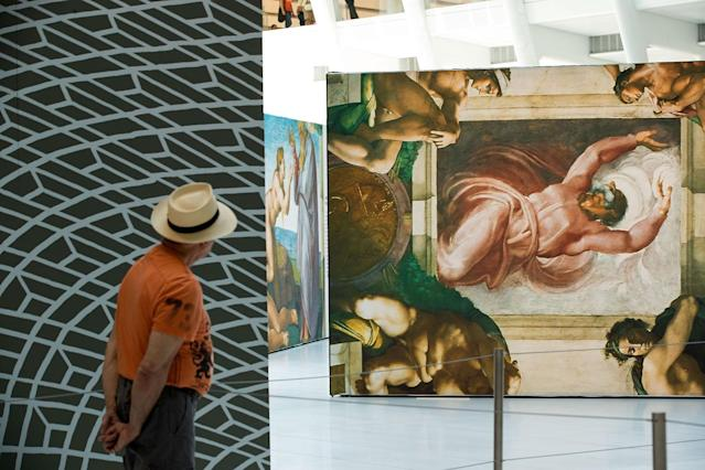 <p>A man views replicas of Michelangelo's Sistine Chapel frescoes inside of the Oculus at the World Trade Center Transportation Hub in New York City. The exhibit contains 34 nearly life-size copies of the frescoes. (Photo by Drew Angerer/Getty Images) </p>