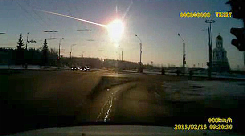 In this frame grab made from dashboard camera vide shows a meteor streaking through the sky over Chelyabinsk, about 930 miles east of Moscow, Friday, Feb. 15, 2013. After a surprise meteor hit Earth at 42,000 mph and exploded over a Russian city in February, smashing windows and causing minor injuries, scientists studying the aftermath say the threat of space rocks hurtling toward our planet is bigger than they had thought. Meteors like the one that exploded over Chelyabinsk _ and those that are even bigger and more dangerous _ are probably four to five times more likely to hit Earth than scientists thought before the February mid-air explosion, according to three studies released Wednesday in the journals Nature and Science. (AP Photo/AP Video)