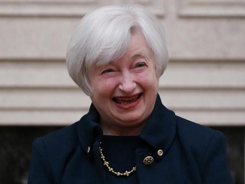 Janet Yellen reacts to applause by staff members after she was sworn in as Federal Reserve Board chair, Monday, Feb. 3, 2014, at the Federal Reserve in Washington, Yellen is the first woman to lead the Federal Reserve. (AP Photo/Charles Dharapak)