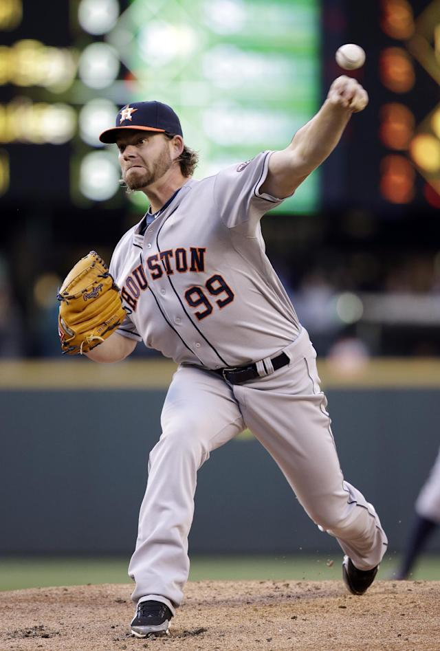 Houston Astros starting pitcher Rudy Owens throws his first major league pitch, against the Seattle Mariners in the first inning of a baseball game Friday, May 23, 2014, in Seattle. (AP Photo/Elaine Thompson)