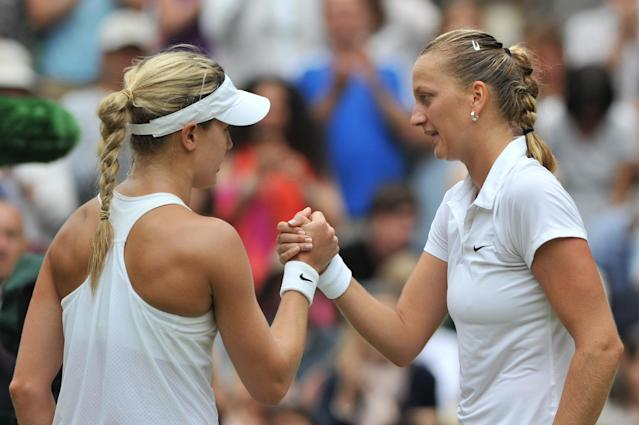 Czech Republic's Petra Kvitova (R) shakes hands with Canada's Eugenie Bouchard after their women's singles final on day 12 of the Wimbledon Championships at The All England Tennis Club in southwest London, on July 5, 2014 (AFP Photo/Glyn Kirk)