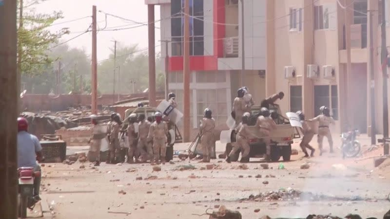 FILE PHOTO: Video grab of riot policemen detaining protesters in Niamey, Niger